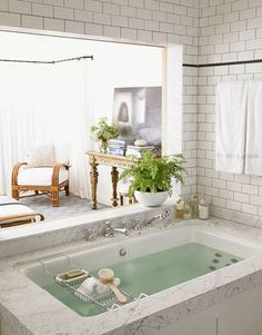 The master bath is open to the master bedroom, so the owners can see the ocean from the tub.  OMG, I wanna a master bathroom like this in my house >.