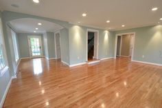 good w/grey kitchen -- Benjamin Moore Palladian Blue. Love the wood floors, lighting, and open floorplan too! From 530 Miles Away: The backside House Design, House, Living Room Paint, Home, Living Room Colors, Paint Colors For Living Room, New Homes, Palladian Blue, House Colors