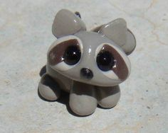 Tiny Clay Raccoon- polymer clay. $10.00, via Etsy.