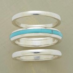 Oh man. love it. A hand inlaid turquoise streak embellishes the center ring in our exclusive sterling bands trio. Set of 3. Whole sizes 5 to 9.