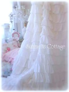 white ruffles curtain ~ may use in a backdrop....