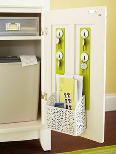 Organize Your Entry  Enhance the style and storage of your entryway with a designated place for important drop-zone items. Create a mini hang-up station for house keys and outgoing mail on the back of a cabinet door. Use magnetic strips, Peg-Board or an old ceiling tin and add hooks to store items in one convenient location near the door.