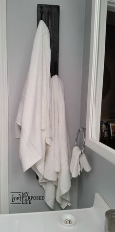 A vertical coat rack is the perfect solution for tight spaces. Use it in the bathroom for towels, by the front door for hats and coats. Use it low for kids.