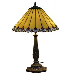 @Overstock.com - This 'Touch Of Class' Tiffany style lamp is a very elegant table lamp made with more than 180 hand-cut pieces of glass and 36 'jewels' soldered into a beautiful shade. This piece is handcrafted using techniques developed by Louis Comfort Tiffany.http://www.overstock.com/Home-Garden/Handcrafted-Touch-Of-Class-Stained-Glass-Tiffany-Style-Table-Lamp/7315868/product.html?CID=214117 $143.99