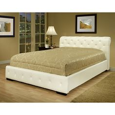 Set a decidedly contemporary vibe in your space with this king-size white faux-leather bed. This sleek, modern bed features solid hardwood construction with bicast leather upholstery in a slat design that does not require a box-spring foundation.
