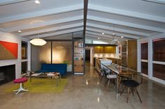 Kitchen, dining and living rooms with polished concrete floors