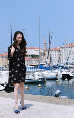 Fashion blogger Veronika Lipar of Brunette From Wall Street on her stroll through the seaside town wearing shirt dress and raffia basket bag