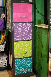 Mod Podge scrapbook paper on filing cabinet. A good way to make a hideous, rusty filing cabinet look more appealing!