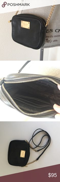 4d8cd004acdb Michael Kors Small Purse Michael Kors Small Purse - black with gold hard  ware. On inside  4 credit card slots on one side and other is open slot.