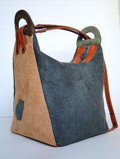 Very clever! Can wear as a backpack or a hobo... fascinating blog site where good photos show the interior and base of the bag ~ inspiration for seamstresses who are well advanced in their skills.