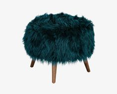 Scandinavian Designs - You can effortlessly add personality to your living room or bedroom with the Morten ottoman. This fun design has a whimsical faux fir cushion supported by tapered wood legs.