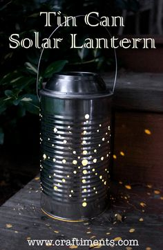 Learn how to make a recycled tin can lantern powered by a solar garden light. #tutorial