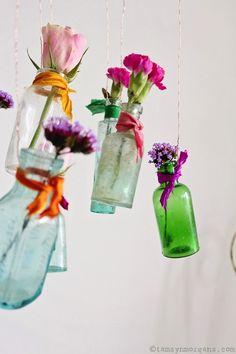 Mollie Makes Calendar – April.  A floral chandelier made with vintage bottles...