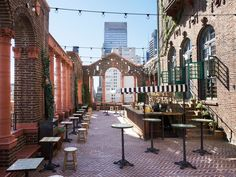 """Toast to the past on the 17th floor of this c. 1916 building, now housing the """"young-minded"""" Pod 39 Hotel. Original brick arches and terra cotta columns frame the roof, punctuated by crawling ivy, potted plants, and Mexican-tiled tables. You'll catch a glimpse of 1 World Trade Center and the Empire State Building from this 39th Street and Lexington location, but it's more likely that your eyes will be on the crowd."""