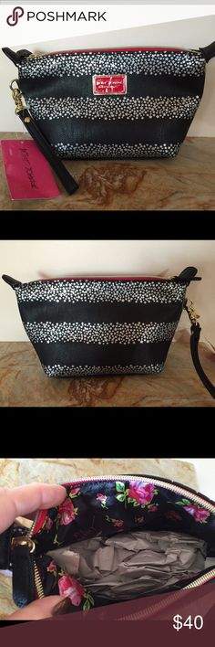 🎄Betsey Johnson Travel Makeup Bag🎄 Brand New. Tags Attached. Betsey Johnson Travel Makeup Bag. Black & Silver. Pretty Floral Print Inside. Has a Hand Strap. Makes A Perfect Christmas Gift 🎁 Betsey Johnson Bags Cosmetic Bags & Cases