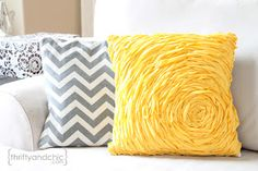 Rosette Pillow Tutorial -she didn't sew and used glue, but I think I'll sew for better hold up