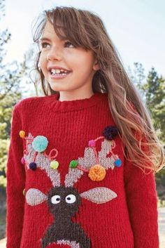This fun, colourful xmas jumper is a great gift for a little girl!