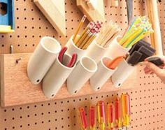 Storage pockets for skinny things ~ Saw off short pieces of 1-1/2-, 2- or 3-in. PVC plumbing pipe with 45-degree angles on one end. Screw them to a board to hold paintbrushes, pencils, stir sticks and just about any other narrow paraphernalia in your garage. Mount them by drilling a 1/4-in. hole in the angled end, and then drive a 1-5/8-in. drywall screw through the hole into the board.