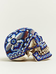 Beaded skulls created by Our Exquisite Corpse in collaboration with the Huichol people of Mexico | The Khooll