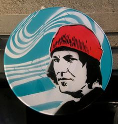 Elliott Smith Portrait with Figure 8 Spray-Painted on Record (Vinyl) BUY any 3 RECORDS get a 4th FREE. $30.00, via Etsy.
