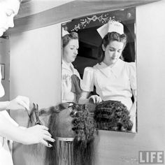 Learning to do various hairstyles during a day of beauty school classes during the 1940's. #student #vintage #1940s #beauty #school #hair