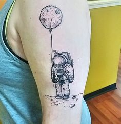 Taylor Anne Tattoos in Georgia worked on Reddit user caitapus's little astronaut with moon balloon, which we adore. The tattoo was based on this original drawing.