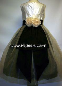 THIS CUSTOMER CHOSE TO BASE HER FLOWER GIRL DRESSES ON STYLE 313 AND WANTED THE SKIRT TO BE IN BLACK FOR A COLOR SWAP. COLOR SWAPS ARE IN INCLUDED IN THE PRICE OF YOUR DRESS. SHE ALSO WANTED US TO ADD IVORY TULLE ON TOP