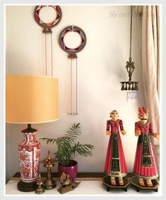 (This lovely corner features traditional brass South-Indian artifacts, Maasai Tribal Wedding Necklace from Kenya and Rajasthani hand painted wooden figurines.)