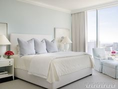 Soft light blue master bedroom with blue pillow touches home the master bedrooms light blue walls not only pull in the color scheme from the nearby living room but also add dimension to the space aloadofball Gallery