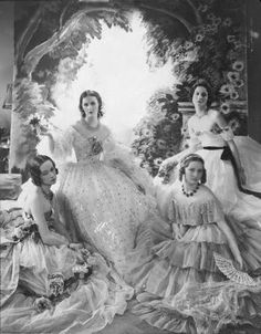 The Famous Beauties Ball, Baba Beaton (second from left) surrounded by Jess Chattock, Nancy Mitford, and Carol Prickard in enormous pageant dresses. by Cecil Beaton. Diana Mitford, Nancy Mitford, Mitford Sisters, Vintage Pictures, Old Pictures, Vintage Images, Old Photos, Iconic Photos, Antique Photos
