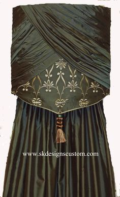 Another great way to add a narrow window treatment between windows by www.skdesignscustom.com.  Silk drapery panel in taffeta silk by Catania with rouched and overlapped mini cornice accented with embroidered silk underlay in Catania silk in Arctic Blue colorway.