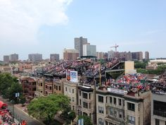 Stand on the house across the road from Wrigley Field