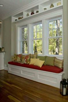 Woodwork design on window seat; window design; cubbies above