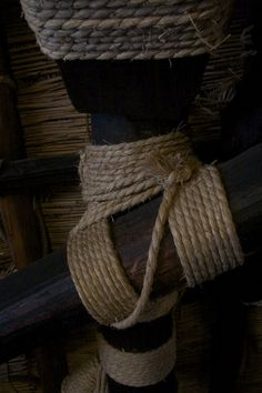 Woods are tied with straw ropes. A wooden house with a steep rafter roof in Shirakawa-go.