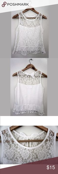 """Abercrombie and Fitch Lace Sleeveless Shirt Top This a pre-owned women's Abercrombie & Fitch White Lace Sleeveless Top. The shirt has two small snags, which are shown in picture #7.  Materials of Non-lace undershirt: 60% Cotton 40% Polyester Materials of Lace: 60% Cotton 40% Nylon  Care: Hand wash cold  Measurements: Shoulder to Shoulder: 13"""" Chest (Armpit To Armpit): 16.5"""" Waist:16.5"""" Bottom Hem:17.5"""" Length (Top of collar to bottom hem): 21"""" Arm opening from shoulder down to arm pit:8.5""""…"""