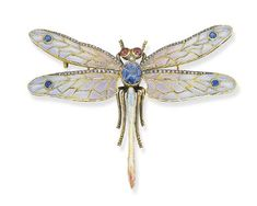 A PLIQUE-A-JOUR ENAMEL, DIAMOND, SAPPHIRE AND RUBY DRAGONFLY BROOCH Designed with plique-a-jour enamel wings enhanced by single-cut diamonds to the cushion-shaped sapphire body and cabochon ruby eyes, mounted in 18k gold