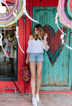 Browse the best summer street style outfit ideas at @stylecaster | 'Tuula' blogger's off-the-shoulder blouse, denim shorts, white sneakers