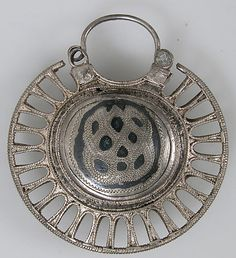 Date: 11th–12th century Geography: Made in Kiev Culture: Kievan Rus' Medium: Silver, niello Dimensions: Overall: 2 x 2 3/16 x 5/8 in. (5.1 x 5.5 x 1.6 cm)