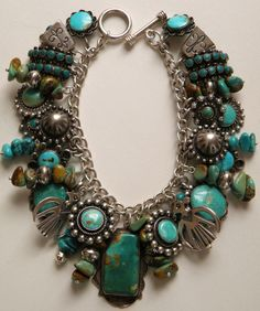 Vintage Fred Harvey era turquoise and silver charm bracelet Zuni Navajo pieces