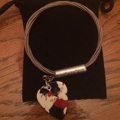 Very cool bracelet made by a Detroit artist with Fender original guitar strings & Fender guitar pick , awesome piece for the rocks star in your life !!!  8 inch  stiff bangle !!! I wear a size 7-7.5 bracelet and this fits me !!!