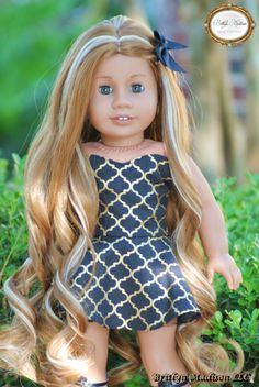A custom Addy Mold with grey eyes and our Gorgeous super luxurious Caramel Macchiato wig.