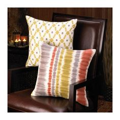 SAFARI THROW PILLOW  African-inspired design makes this neutral throw pillow an international sensation. Rich gold and calming taupe mingle to form a captivating pattern on an off-white cushion, a great addition to any comfortable spot. Spot clean only.