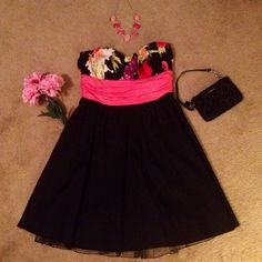 Strapless Dress (size 3) Great condition and very nice! Strapless dress with black tool underlay. No ties... Zips up in back. Beautiful floral design. Perfect for a school dance or to wear to a special event. Smoke free home! Dresses Strapless