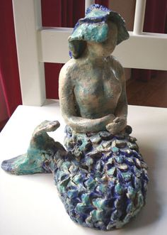 Ceramic mermaid...would like to have her in my garden!