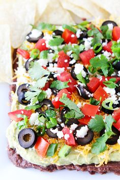 Mexican Layer Dip Recipe on twopeasandtheirpod.com Grab a chip and get dipping! This easy 7 Layer Dip is always a favorite!