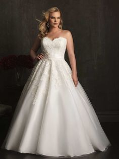 A ball gown I would consider, maybe take some tool out of the bottom so it's more natural?  Allure Bridals: Style: W320