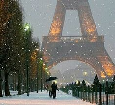 Snowy Paris, snowflakes and fairy lights, and Christmas and your dreams come true. Winter in Paris, France.