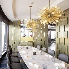 Beautiful Arteriors Home pendants! Golden, glowing and totally contemporary.