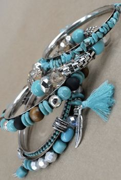 No Turquoise Blues Bracelet - In pretty shades of turquoise blues, grey, clear and silver these casual bracelets are a delight to wear with your favorite weekend outfit. With four main silver bangles with a combination of round, oval, and hexagonal beads, this combination fits all the fun you need - no blues allowed! Available in Turquoise/Silver.