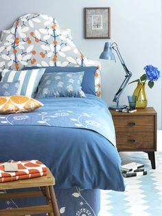 Upholster your headboard in a dramatic print and layer up the bed with cushions made up in fresh, denim-coloured fabrics. Inject a juicy orange shade to bring your scheme to life. Kids Bedroom Furniture, Bedroom Decor, Bedroom Ideas, Furniture Ideas, Bedroom Storage, Bedroom Organization, Closet Storage, Cozy Bedroom, Bedroom Lighting